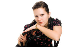 Sad woman in retro style sitting on a chair Royalty Free Stock Image