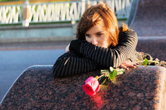 Sad woman with a rose Stock Photo