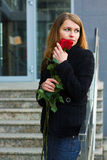 Sad woman with a roses Royalty Free Stock Photo