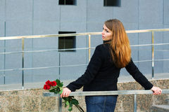 Sad woman with a roses. Stock Image
