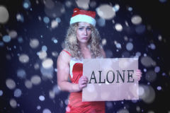 Sad woman in Santa claus clothes Stock Images