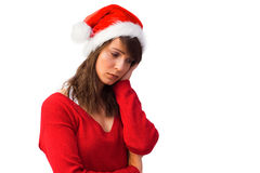 Sad woman in santa hat holding her head Royalty Free Stock Image