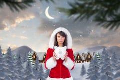 Sad woman in santa hat holding piggybank royalty free stock photo