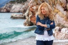 Sad woman. On a seaside royalty free stock photos