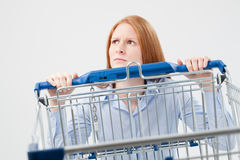 Sad Woman with Shopping Cart Stock Images