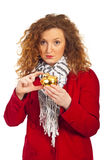 Sad woman showing a small piggy bank. Sad woman in autumn jacket gesturing and showing a small piggy bank isolated on white background Royalty Free Stock Photo