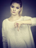 Sad woman showing thumb down gesture Royalty Free Stock Photo