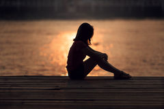 Sad woman silhouette worried. At sunset Stock Photography