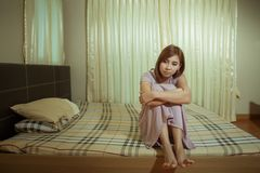 Sad woman sitting on the bed Royalty Free Stock Photos
