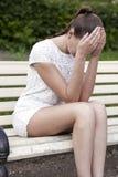 Sad woman sitting on bench Royalty Free Stock Photo