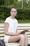 Sad woman sitting on bench Stock Images