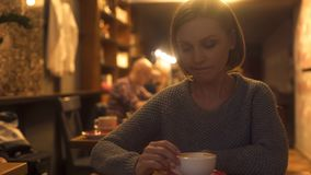 Sad woman sitting in cafe, painfully experiencing break-up, loneliness, crisis. Stock photo stock images