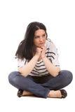 Sad woman sitting on floor Stock Images