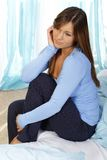 Sad woman sitting on her bed. With depression Stock Photo
