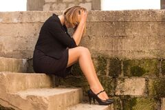 Free Sad Woman Sitting On The  Stairs Of An Abandoned Building. Upset Lonely Desperate Girl Stressed With Broken Heart In Black Stock Image - 171596011