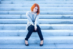 Sad woman sitting outside and waiting for someone Stock Photo