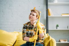 sad woman sitting on sofa with mop royalty free stock image