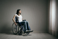 Sad woman sitting on wheelchair Stock Image