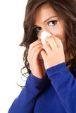 Sad woman with snotty, runny nose and handkerchief Stock Images