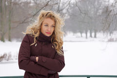 Sad woman in snow covered winter landscape Stock Photos