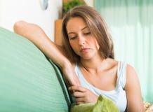 Sad  woman on sofa Stock Photography