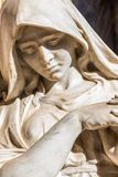 Sad woman. Statue of sad woman looking down with reclined head and hands together in prayer Royalty Free Stock Photography