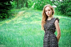 Sad woman stays in a forest Royalty Free Stock Photos