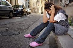 Sad woman in street Royalty Free Stock Image