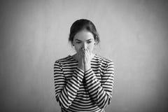 Sad woman in a striped vest Stock Image