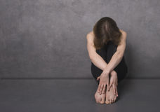 Sad woman, studio shot royalty free stock image