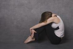 Sad woman, studio shot royalty free stock images