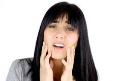 Sad woman suffering pain because of dead teeth Royalty Free Stock Images