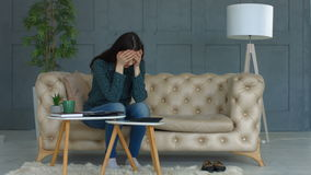 Sad woman suffering stress doing home accounting stock footage