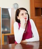 Sad  woman at table Stock Photos