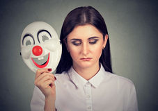 Free Sad Woman Taking Off Clown Mask Expressing Happiness Stock Photo - 95584420