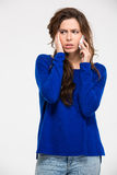 Sad woman talking on the phone Stock Photos