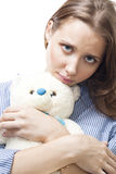 Sad woman with teddy bear Royalty Free Stock Image
