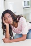 Sad woman thinking at the counter Royalty Free Stock Photos