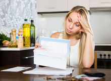 Sad   woman thinking about the financial problems Royalty Free Stock Image