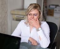 Sad woman thinking about future at job. In office stock images