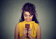 Sad woman tired of diet restrictions craving sweets chocolate bar Royalty Free Stock Photo