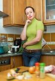 Sad woman tired to cook Stock Image