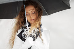 Sad woman with umbrella Stock Photography