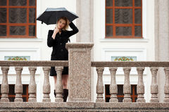 Sad woman with umbrella in the rain Royalty Free Stock Images
