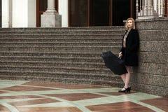 Sad woman with umbrella at the wall Royalty Free Stock Photography