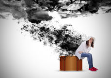 Sad woman under the black clouds. With paint splashes Stock Photos