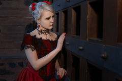 Sad woman in a vintage dress with lace. stock photo