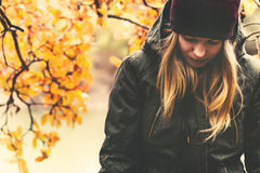 Sad Woman walking in park Seasonal melancholy. Sad Woman walking in park with autumn leaves on background outdoor Seasonal melancholy Lifestyle concept stock image