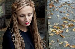Sad woman with wattled braids Stock Images