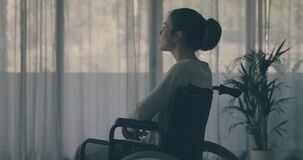 Sad lonely woman in wheelchair